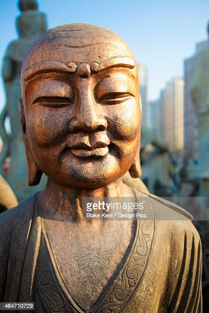 Bronze Faced Buddha Statue Glowing In Warm Light