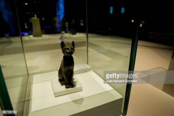 A bronze figure of Bastet as a seated cat is displayed as part of the 'Treasures of the World's Cultures' exhibition at Centro Exposiciones Arte...