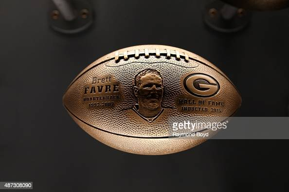 A bronze football honoring Brett Favre is on display inside the Green Bay Packers 'Hall Of Fame' inductees room inside the Lambeau Field atrium on...