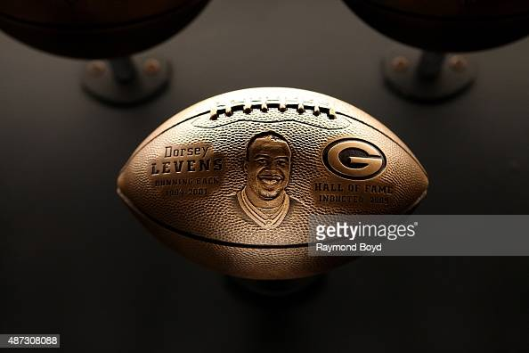 A bronze football honoring Dorsey Levens is on display inside the Green Bay Packers 'Hall Of Fame' inductees room inside the Lambeau Field atrium on...