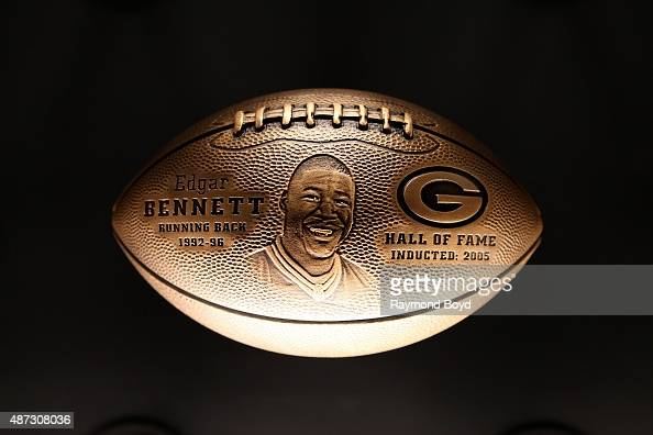 A bronze football honoring Edgar Bennett is on display inside the Green Bay Packers 'Hall Of Fame' inductees room inside the Lambeau Field atrium on...