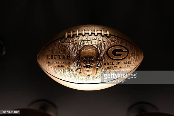 A bronze football honoring James Lofton is on display inside the Green Bay Packers 'Hall Of Fame' inductees room inside the Lambeau Field atrium on...