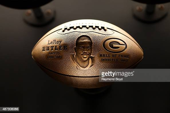 A bronze football honoring LeRoy Butler is on display inside the Green Bay Packers 'Hall Of Fame' inductees room inside the Lambeau Field atrium on...