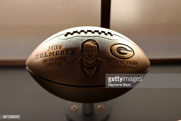 A bronze football honoring Mike Holmgren is on display inside the Green Bay Packers 'Hall Of Fame' inductees room inside the Lambeau Field atrium on...
