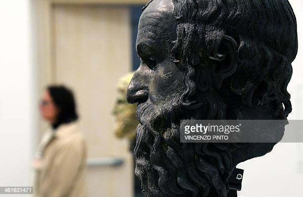 Bronze head ' The philosopher ' is displayed in a renovated Reggio Calabria National Archeological Museum on January 9 together with the Riace...