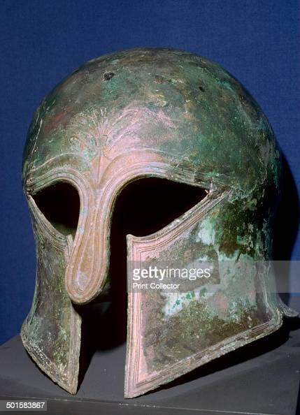 A bronze helmet of the Corinthian type which protected the face and especially the cheek bones but impaired the wearer's field of vision 6th century...