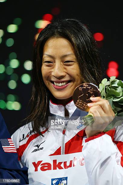 Bronze medal winner Aya Terakawa of Japan celebrates on the podium after the Swimming Women's 100m Backstroke Final on day eleven of the 15th FINA...