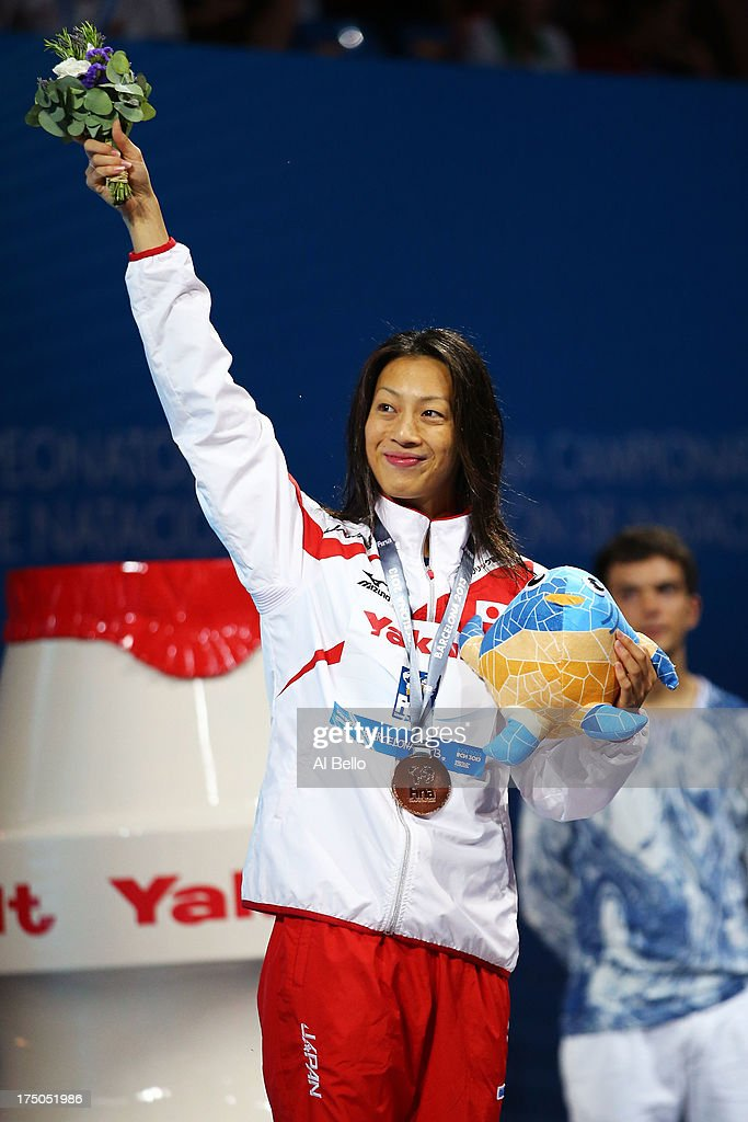 Bronze medal winner Aya Terakawa of Japan celebrates on the podium after the Swimming Women's 100m Backstroke Final on day eleven of the 15th FINA World Championships at Palau Sant Jordi on July 30, 2013 in Barcelona, Spain.
