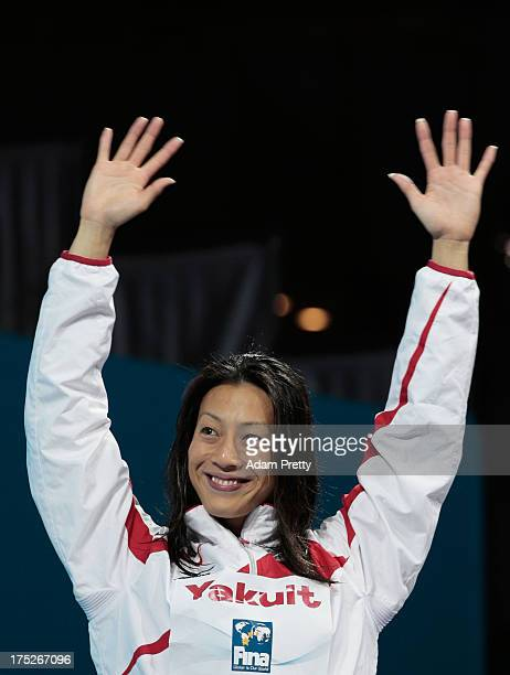 Bronze medal winner Aya Terakawa of Japan celebrates on the podium after the Swimming Women's Backstroke 50m Final on day thirteen of the 15th FINA...
