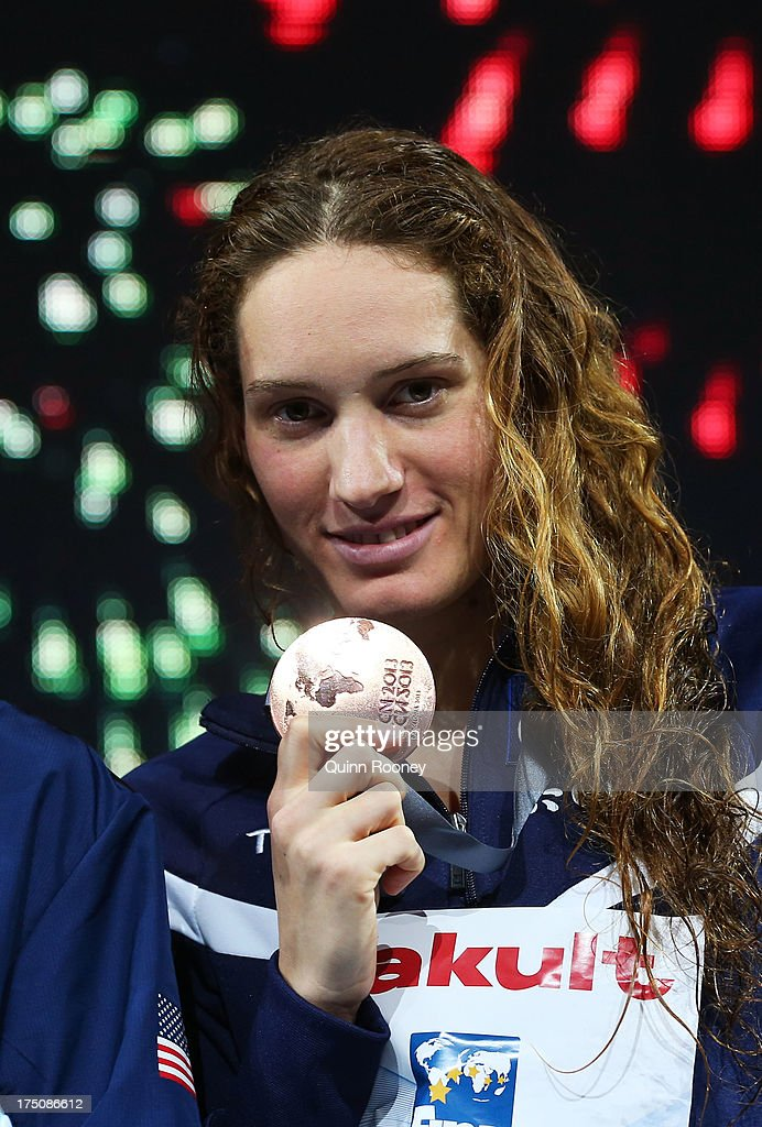 Bronze medal winner Camille Muffat of France celebrates on the podium after the Swimming Women's 200m Freestyle Final on day twelve of the 15th FINA...