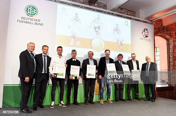 Bronze medal winner Constantin Frommann and silver medal winner Niklas Dorsch of Bayern Muenchen are seen on the stage during the Fritz Walter Medal...