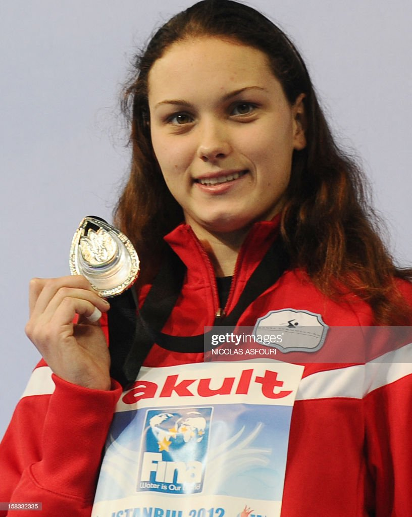 Bronze medal winner Czech Baumrtova Simona poses with her medal after the women`s 100m backstroke on December 13, 2012 of the FINA World Short Course Swimming Championships in Istanbul.