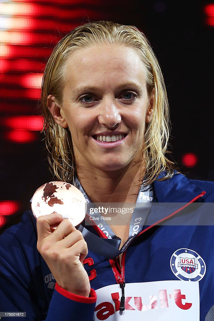 Bronze medal winner <a gi-track='captionPersonalityLinkClicked' href=/galleries/search?phrase=Dana+Vollmer&family=editorial&specificpeople=240582 ng-click='$event.stopPropagation()'>Dana Vollmer</a> of the USA celebrates on the podium after the Swimming Women's 100m Butterfly Final on day ten of the 15th FINA World Championships at Palau Sant Jordi on July 29, 2013 in Barcelona, Spain.
