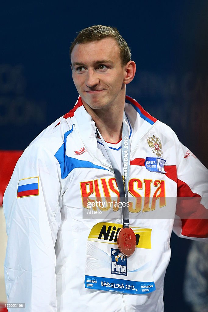 Bronze medal winner Danila Izotov of Russia celebrates on the podium after the Swimming Men's 200m Freestyle Final on day eleven of the 15th FINA World Championships at Palau Sant Jordi on July 30, 2013 in Barcelona, Spain.