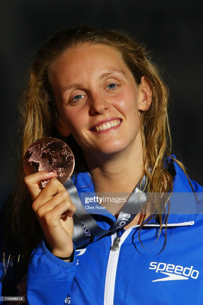 Bronze medal winner Francesca Halsall of Great Britain celebrates on the podium after the Swimming Women's Freestyle 50m Final on day sixteen of the 15th FINA World Championships at Palau Sant Jordi on August 4, 2013 in Barcelona, Spain.