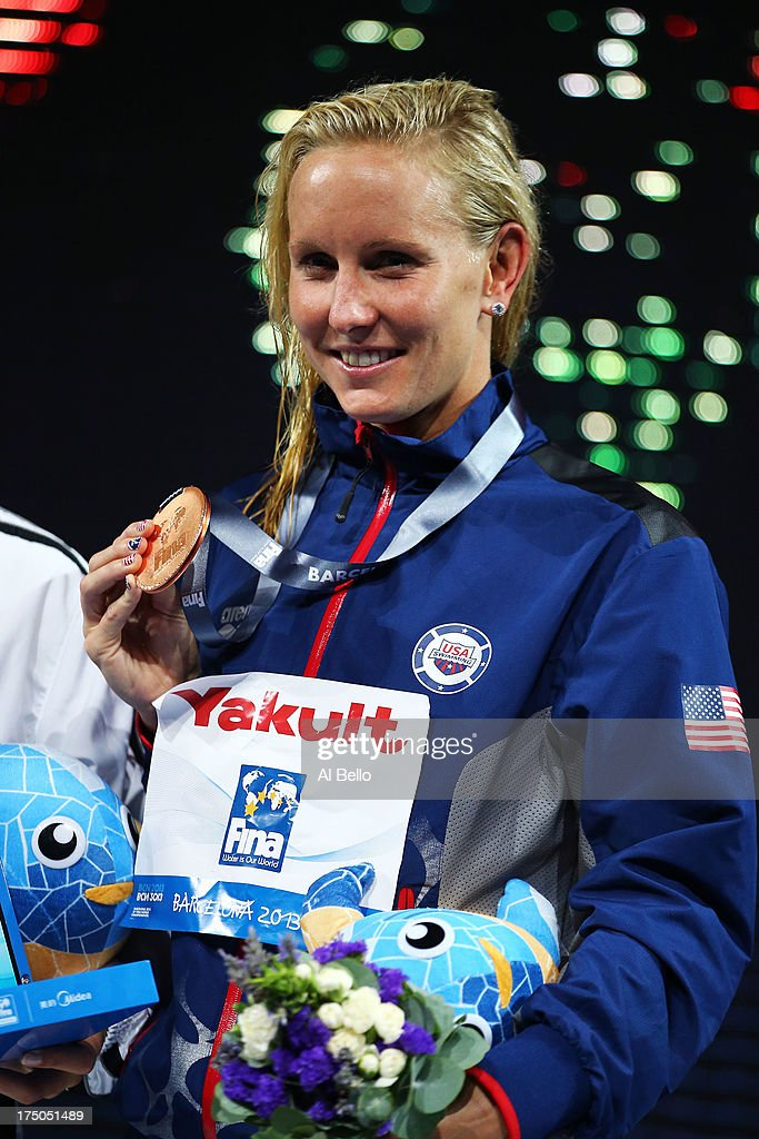 Bronze medal winner Jessica Hardy of the USA celebrates on the podium after the Swimming Women's 100m Breastroke Final on day eleven of the 15th FINA World Championships at Palau Sant Jordi on July 30, 2013 in Barcelona, Spain.