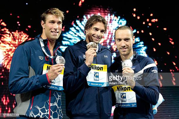 Bronze medal winner Matt Greevers of the USA Gold medal winner Camille Lacourt of France and Silver medal winner Jeremy Stravius of France celebrate...