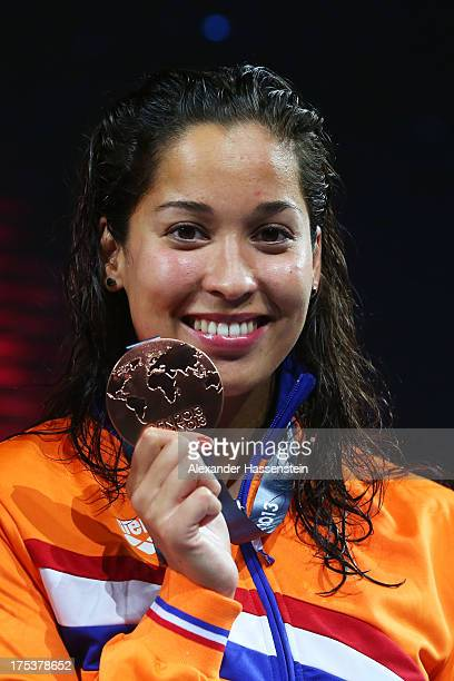 Bronze medal winner Ranomi Kromowidjojo of the Netherlands celebrates on the podium after the Swimming Women's Butterfly 50m Final on day fifteen of...