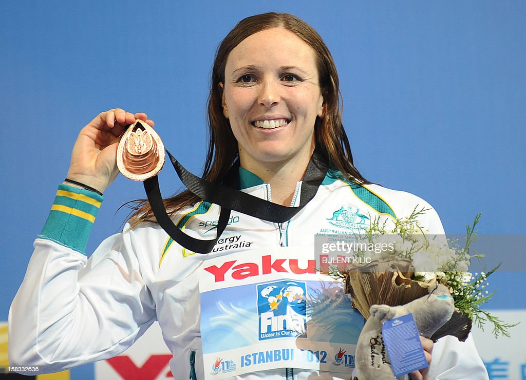 Bronze medal winner Sarah Karsoulis of Australia poses after the women`s 50m breasttroke on December 13, 2012 of the FINA World Short Course Swimming Championships in Istanbul.