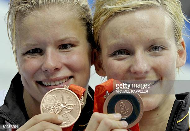 Bronze medal winners Ditte Kotzian and Heike Fischer pose after the women's synchronised 3m springboard diving competition final at the 2008 Beijing...
