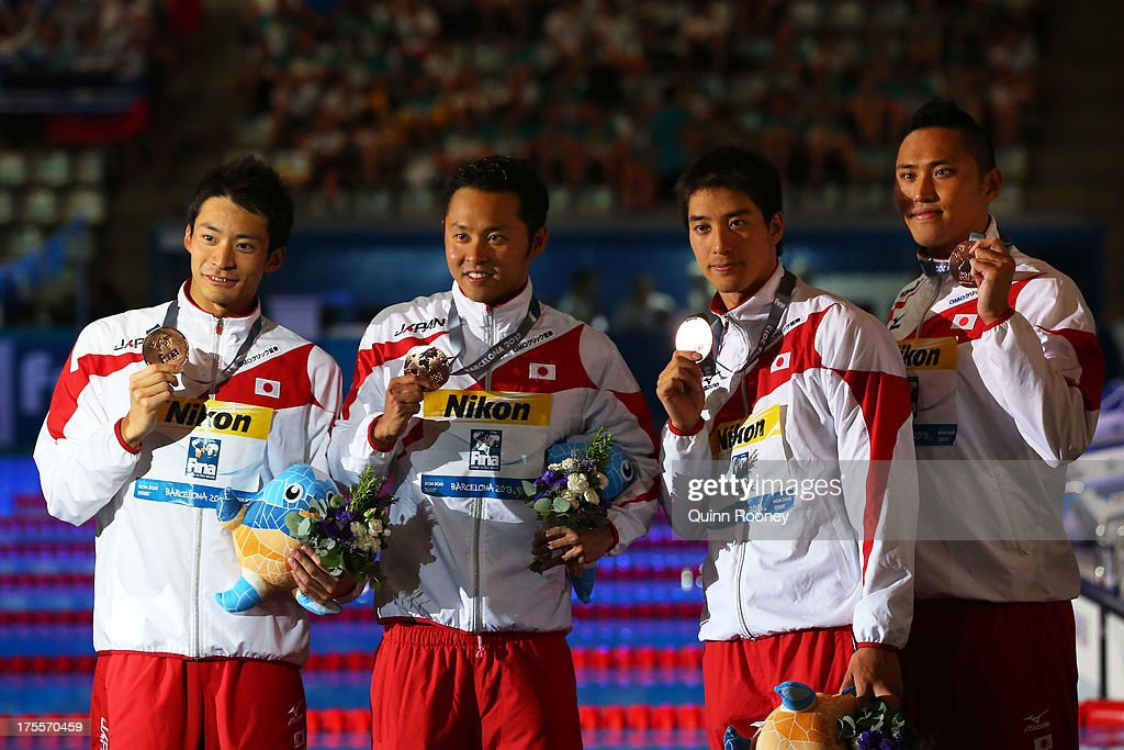 Bronze medal winners <a gi-track='captionPersonalityLinkClicked' href=/galleries/search?phrase=Ryosuke+Irie&family=editorial&specificpeople=4057991 ng-click='$event.stopPropagation()'>Ryosuke Irie</a>, <a gi-track='captionPersonalityLinkClicked' href=/galleries/search?phrase=Kosuke+Kitajima&family=editorial&specificpeople=178303 ng-click='$event.stopPropagation()'>Kosuke Kitajima</a>, <a gi-track='captionPersonalityLinkClicked' href=/galleries/search?phrase=Takuro+Fujii&family=editorial&specificpeople=5134410 ng-click='$event.stopPropagation()'>Takuro Fujii</a> and Shinri Shioura of Japan celebrate on the podium after the Swimming Men's Medley 4x100m Relay Final on day sixteen of the 15th FINA World Championships at Palau Sant Jordi on August 4, 2013 in Barcelona, Spain.