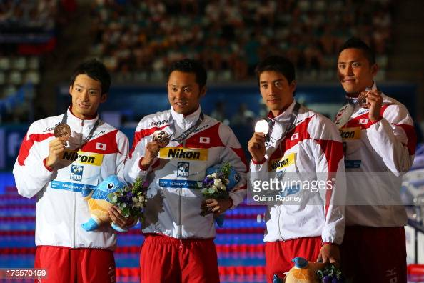 Bronze medal winners Ryosuke Irie Kosuke Kitajima Takuro Fujii and Shinri Shioura of Japan celebrate on the podium after the Swimming Men's Medley...