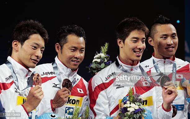 Bronze medal winners Ryosuke Irie Kosuke Kitajima Takuro Fujii and Shinri Shioura of Japan celebrate on the podium after the Swimming Men's Medley...