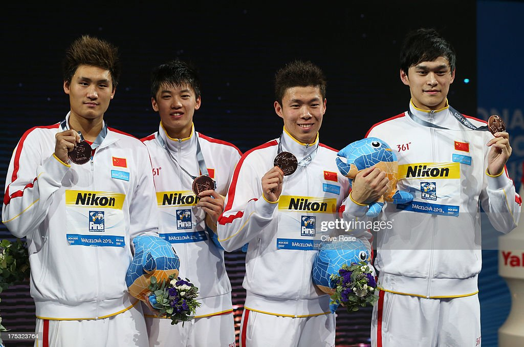 Bronze medal winners Shun Wang, Yun Hao, Yunqi Li and Yang Sun of China celebrate on the podium after the Men's Freestyle 4x200m Final on day fourteen of the 15th FINA World Championships at Palau Sant Jordi on August 2, 2013 in Barcelona, Spain.
