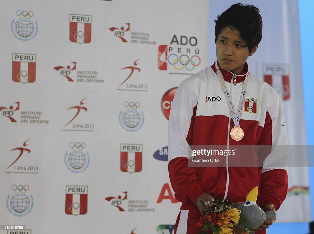 Bronze medalist Abraham Saavedra of Peru in the podium of Greco Roman 58kg as part of the I ODESUR South American Youth Games at Polideportivo Villa Deportiva del Callao on September 26, 2013 in Lima, Peru.
