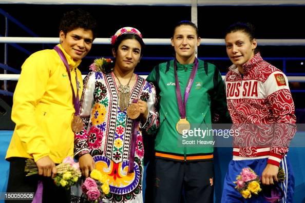 Bronze medalist Adriana Araujo of Brazil bronze medalist Mavzuna Chorieva of Tajikistan gold medalist Katie Taylor of Ireland and silver medalist...