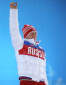 Bronze medalist Alexandr Smyshlyaev of Russia celebrates during the medal ceremony for the Freestyle Skiing Men's Moguls on day 4 of the Sochi 2014...