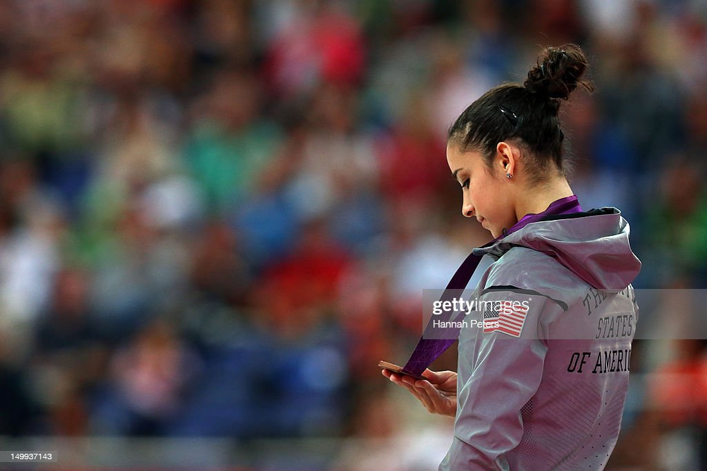 Bronze medalist Alexandra Raisman of the United States poses on the podium during the medal ceremony for the Artistic Gymnastics Women's Beam final on Day 11 of the London 2012 Olympic Games at North Greenwich Arena on August 7, 2012 in London, England.