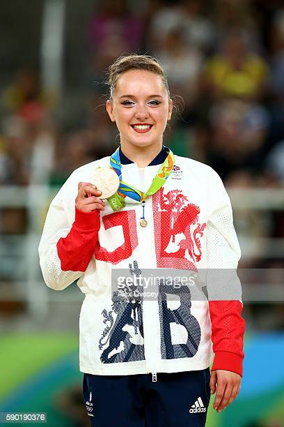 Bronze medalist Amy Tinkler of Great Britain poses for photographs on the podium at the medal ceremony for the Women's Floor on Day 11 of the Rio...