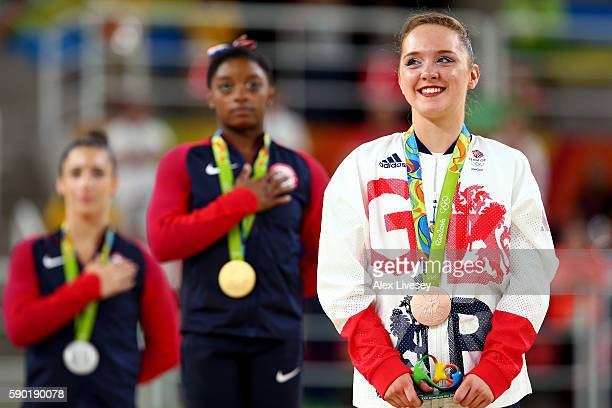 Bronze medalist Amy Tinkler of Great Britain stands for the national anthem on the podium at the medal ceremony for the Women's Floor on Day 11 of...