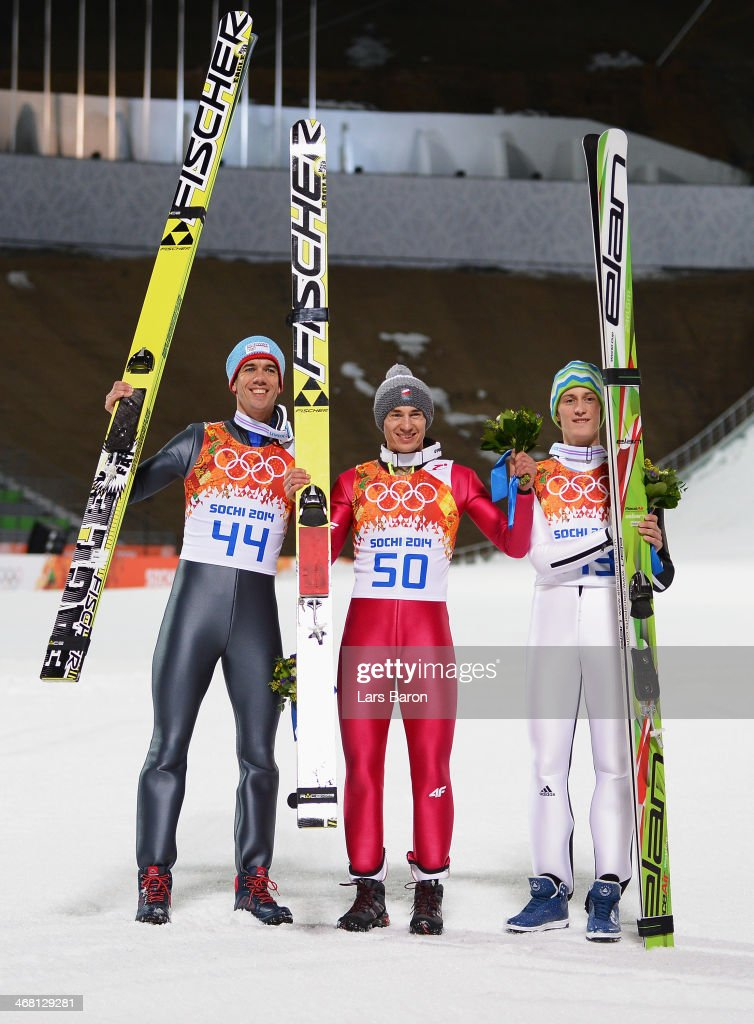 Bronze medalist <a gi-track='captionPersonalityLinkClicked' href=/galleries/search?phrase=Anders+Bardal&family=editorial&specificpeople=2146620 ng-click='$event.stopPropagation()'>Anders Bardal</a> of Norway, gold medalist <a gi-track='captionPersonalityLinkClicked' href=/galleries/search?phrase=Kamil+Stoch&family=editorial&specificpeople=820513 ng-click='$event.stopPropagation()'>Kamil Stoch</a> of Poland and silver medalist <a gi-track='captionPersonalityLinkClicked' href=/galleries/search?phrase=Peter+Prevc&family=editorial&specificpeople=6667561 ng-click='$event.stopPropagation()'>Peter Prevc</a> of Slovenia pose after the flower ceremony for the Men's Normal Hill Individual Final on day 2 of the Sochi 2014 Winter Olympics at the RusSki Gorki Ski Jumping Center on February 9, 2014 in Sochi, Russia.