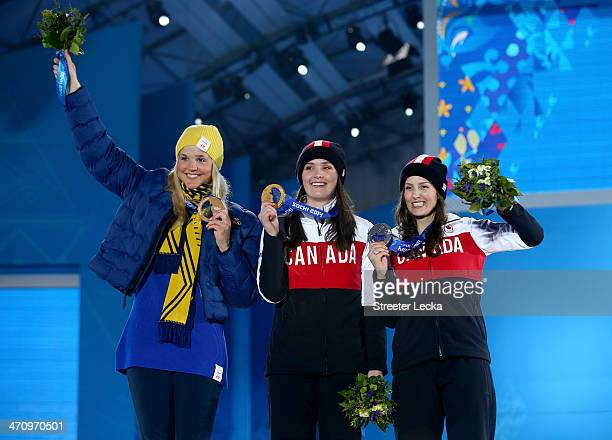 Bronze medalist Anna Holmlund of Sweden Gold medallist Marielle Thompson of Canada and Silver medalist Kelsey Serwa of Canada celebrate during the...