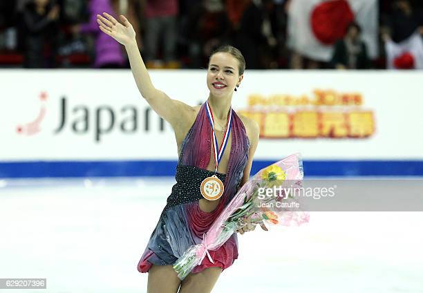 Bronze medalist Anna Pogorilaya of Russia celebrates during Senior Ladies medal ceremony on day three of the ISU Grand Prix of Figure Skating 2016 at...