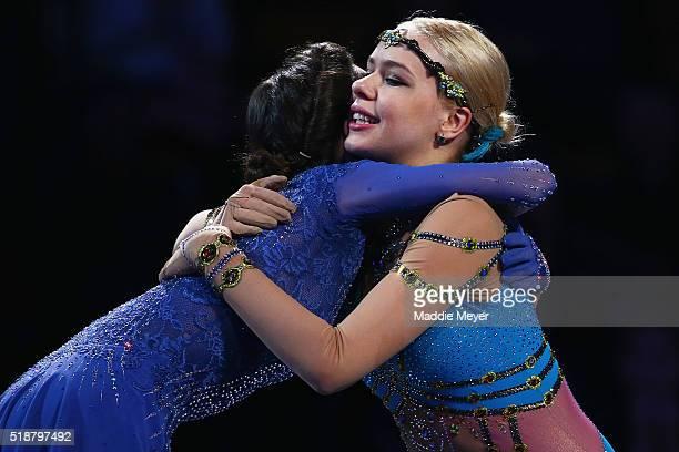 Bronze medalist Anna Pogorilaya of Russia right congratulates gold medalist Evgenia Medvedeva of Russia left on the podium following their...