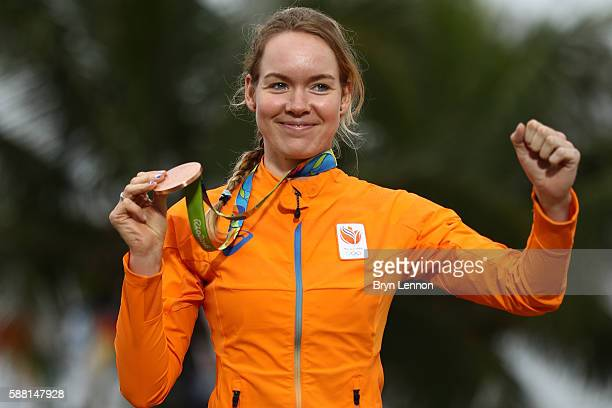 Bronze medalist Anna van der Breggen of the Netherlands celebrates on the podium at the medal ceremony for the Cycling Road Women's Individual Time...
