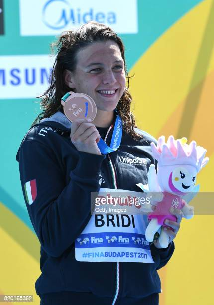 Bronze medalist Arianna Bridi of Italy poses with the medal won during the Women's Open Water Swimmming 25km final on day eight of the Budapest 2017...