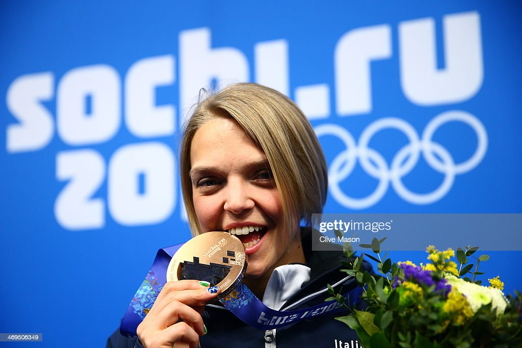 Bronze medalist <a gi-track='captionPersonalityLinkClicked' href=/galleries/search?phrase=Arianna+Fontana&family=editorial&specificpeople=4680451 ng-click='$event.stopPropagation()'>Arianna Fontana</a> of Italy celebrates during the medal ceremony for the Short Track Speed Skating Womenfs 1500m on day 8 of the Sochi 2014 Winter Olympics at Medals Plaza on February 15, 2014 in Sochi, Russia.