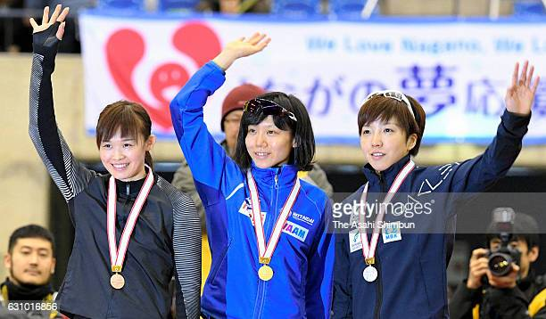 Bronze medalist Arisa Go gold medalist Miho Takagi and silver medalist Nao Kodaira celebrate on the podium at the medal ceremony for the Women's...