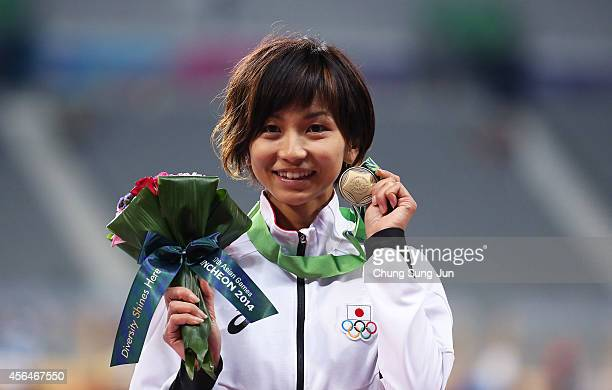 Bronze medalist Ayako Kimura of Japan poses during the medal ceremony of the Women's 100m Hurdles Final on day twelve of the 2014 Asian Games at...