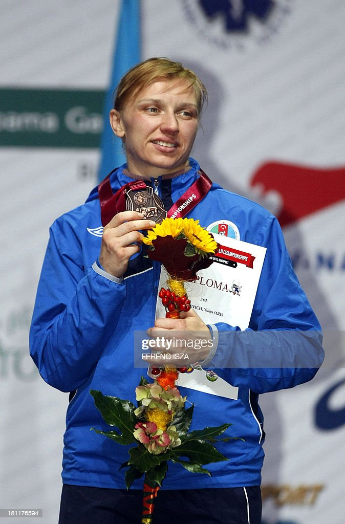 Bronze medalist Azerbaidzan's Yuliya Ratkevich celebrates on the podium of the women's free style 59 kg category of the World Wrestling Championships in Budapest on September 19, 2013.
