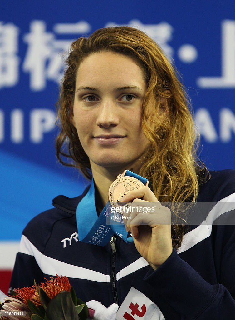 Bronze medalist Camille Muffat of France attends the victory ceremony for the Women's 400m Freestyle Final during Day Nine of the 14th FINA World...