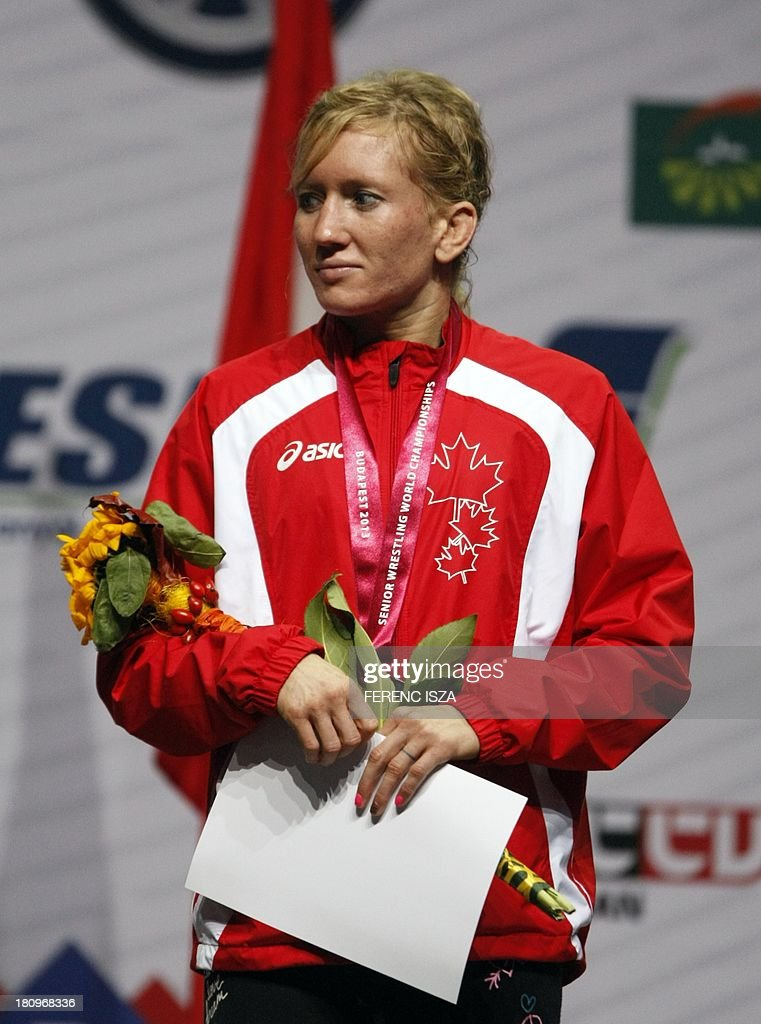 Bronze medalist Canada's Jessica Anne Marie Macdonald Bondy celebrates on the podium of the women's free style 51 kg category of the World Wrestling Championships in Budapest on September 18, 2013.