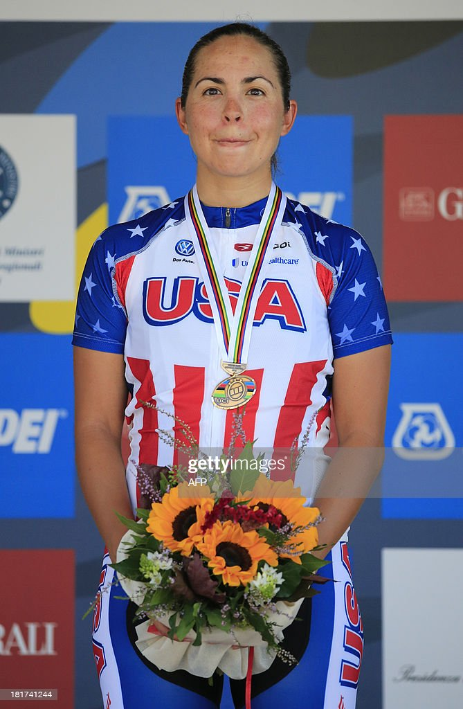 Bronze medalist Carmen Small, poses on the podium after of the Elite Women's Time Trial of the UCI Road World Championships in Tuscany, on September 24, 2013 in Firenze. Ellen Van Dijk of the Netherlands won the race ahead of Linda Villumsen of New Zealand and Carmen Small of the United States.