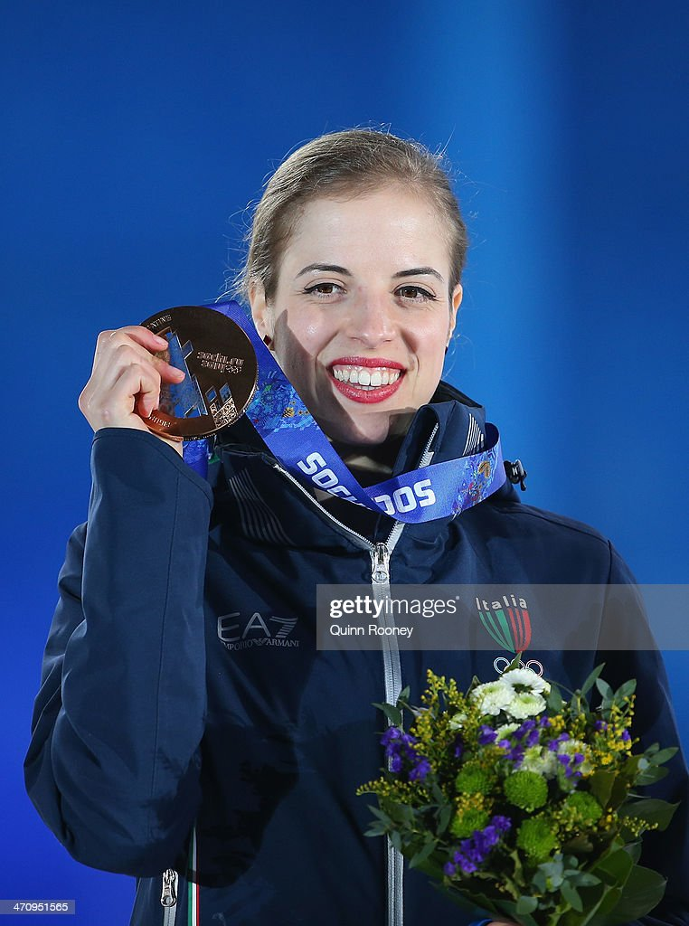Bronze medalist <a gi-track='captionPersonalityLinkClicked' href=/galleries/search?phrase=Carolina+Kostner&family=editorial&specificpeople=729836 ng-click='$event.stopPropagation()'>Carolina Kostner</a> of Italy celebrates during the medal ceremony for the Women's Free Figure Skating on day fourteen of the Sochi 2014 Winter Olympics at Medals Plaza on February 21, 2014 in Sochi, Russia.