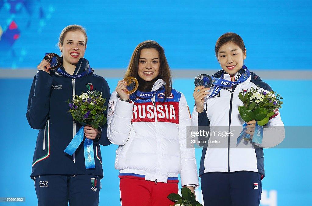 Bronze medalist Carolina Kostner of Italy Gold medalist Adelina Sotnikova of Russia and Silver medalist Yuna Kim of South Korea celebrate during the...