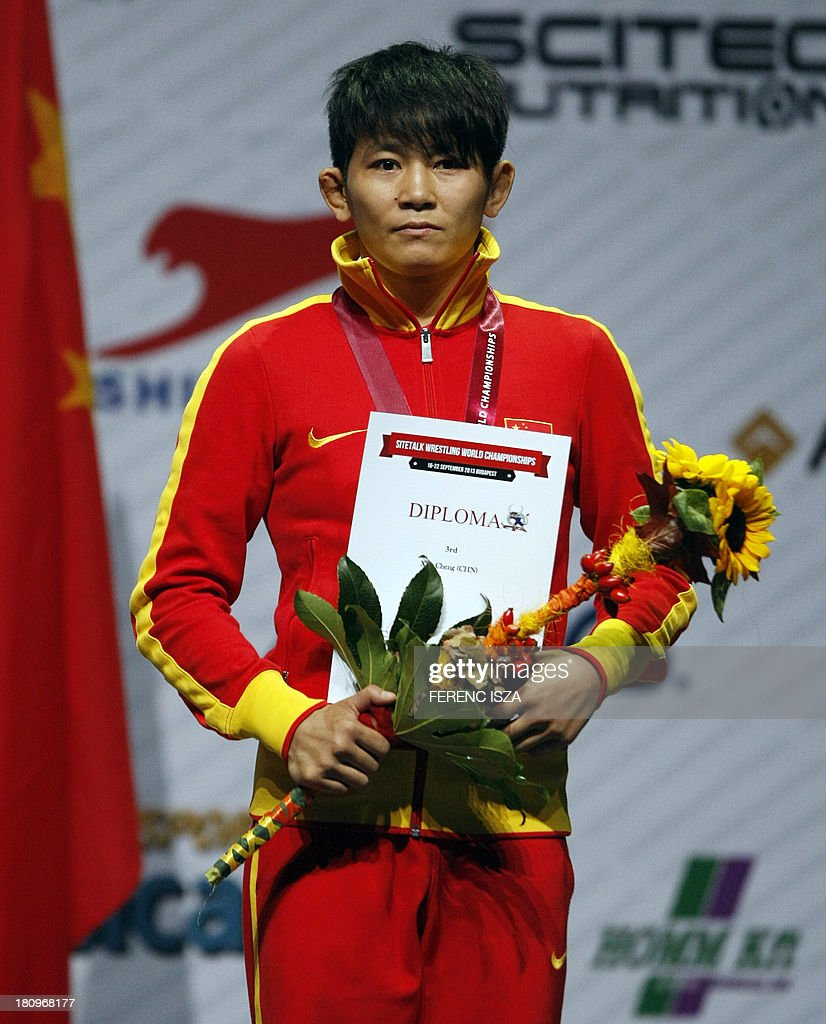 Bronze medalist China's Cheng Xu listens to the national anthem on the podium of the women's free style 48 kg category of the World Wrestling Championships in Budapest on September 18, 2013. AFP PHOTO / FERENC ISZA